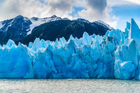 Blue Iceberg of Gracier Grey with the beautiful mountain and Lake Grey