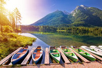 Colorful boats on Hintersee lake in Berchtesgaden Alpine landscape sunrise view