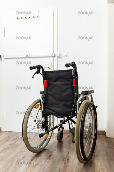 Wheelchair at an apartment door