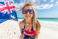 Australian supporter or fan waving flag on the beach