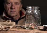Senior retired caucasian man looking at remaining savings