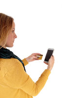 Woman buying with credit card over phone