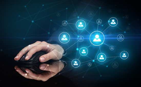 Hand using mouse with human networking concept