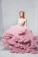 Cute young redhead woman posing in a studio.