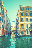 Old buildings by side canals in Venice