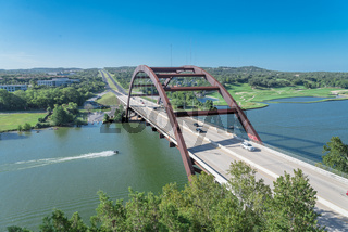 360 Bridge over Colorado river with jet ski and Hill Country landscape in Austin