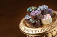 Artisan Fine Chocolate Candy On Gold Pillar Serving Dish