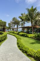 A curved pathway at Dusit Princess Moonrise Beach Resort
