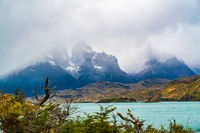 View of Cuernos del Paine covered with fog and lake Pehoe