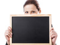 Business woman holding a chalk board