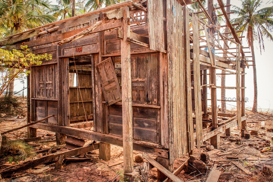 destroyed home at coast , wooden hut ruin / destroyed house made of wood  -