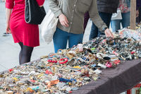 woman looking at jewellery, bracelets and accessories on  market  table  -