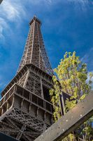 Paris, France, March 30 2017: Tower Eiffel, Paris, seen from the park. Eiffel tower on a beautiful Spring day with a blue sky. Most visited monument in France and the most famous symbol of city Paris