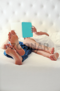 Man and woman reading in the bed