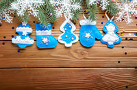 Flat Handmade rustic felt Christmas tree decorations as background on wooden table, place for text.