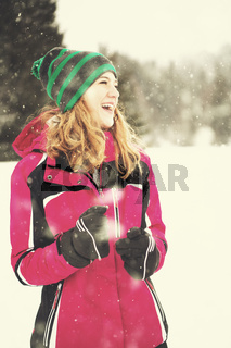Portrait of young woman on snowy winter day