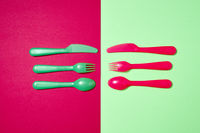 Colorful pattern from plastic eating utensil on a duotone background.