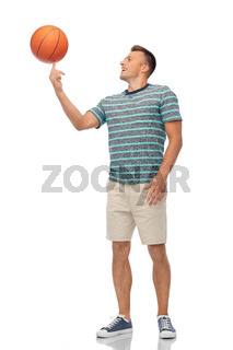 smiling young man spinning ball on finger