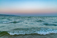 Waves at the beach at sunset in Sunny Beach on the Black Sea coast of Bulgaria