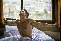 Young Sleepy Man, Lying in Bed Yawning