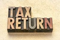 tax return banner in letterpress wood type