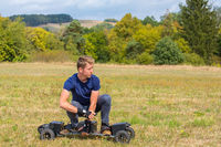 Young dutch man rides electric mountainboard off road