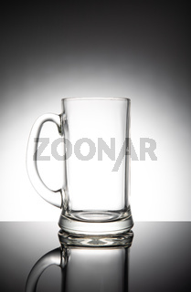 Empty clear beer mug, isolated on white background