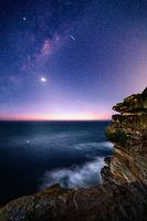 Sydney coast by night with starry milky way sky