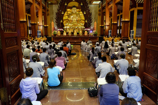 Vietnamese Buddhists read prayer
