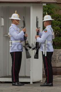 White-jacketed Grand Palace soldiers by sentry box
