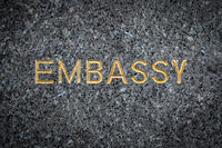Gold Embassy Sign