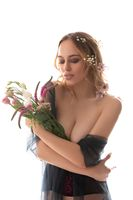 Gorgeous sexy woman with flowers isolated shot