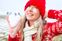 Woman holding a snow heart.  Christmas or winter theme
