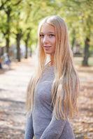 portrait of teenage girl enjoying sunny day outdoors