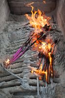 Burning incense sticks with flames