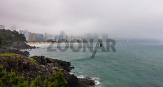 Panorama of Haeundae Beach with Skyline on a foggy day. Haeundae-gu, Busan, South Korea. Asia.