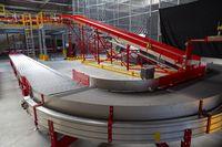 Conveyor sorting belt at distribution warehouse