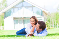 Happy couple laying in home garden