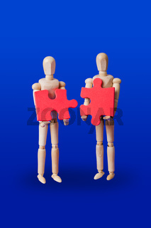 Wooden toy figures with puzzle on blue