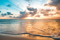 ocean, beach and colorful scenic sunset sky -