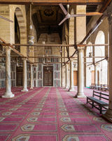 Corridor at mosque of Sultan Moaayad, ending with colorful marble wall and wooden door, Cairo, Egypt