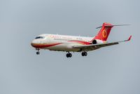 Chengdu airlines COMA ARJ21-700 commercial airplane against sky