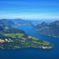 View from Mount Fronalpstock. Lake Lucerne in summer. Green meadows and mountains. Village Seelisber
