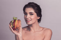Woman with vegan burger