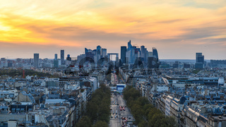 Paris France aerial view city skyline sunset at La Defrense and Champs Elysees street