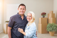 Happy Couple Inside Empty Room with Boxes