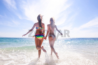Women run on beach