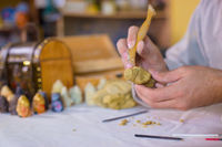 Potter making clay figure for board game