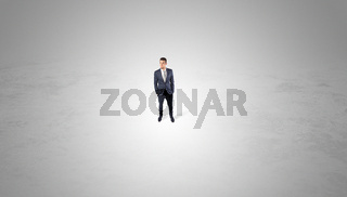 Businessman standing in the middle of an empty space