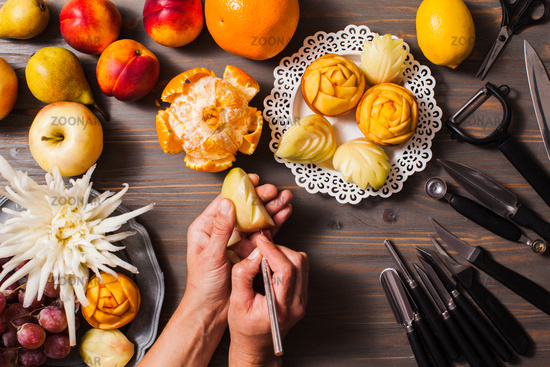 Chinese fruit carving, flat lay hands do it
